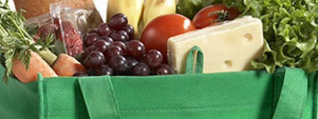 varied food items in green shopping bag